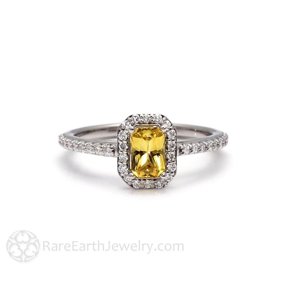 yellow sapphire engagement ring emerald cut halo 14k