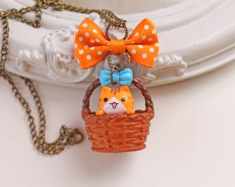 Kawaii orange tabby cat in a basket Necklace with bow lolita kitsch