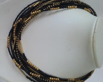 Black and Gold Seed Bead Multi Twelve Strand Necklace