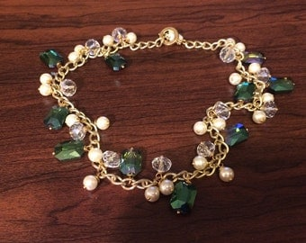 Green crystal encrusted dangle necklace with gold and pearl accents