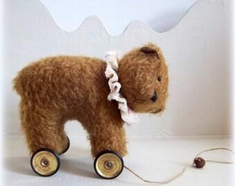 little mohair nutmeg bear on vintage Meccano wheels