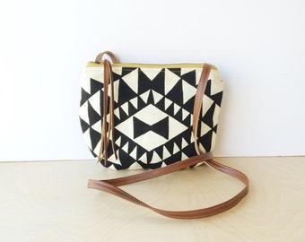 date purse  • small cross body purse - handprinted • black and white triangle geometric print - black canvas • vukani