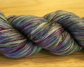 4 Ounces 20/2 Spun Silk Yarn Hand Painted in Ice Wine Colors of Silver, Purple, Moss, and Ice Blue
