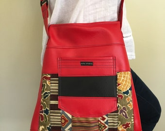 Cross-body with red and patchwork design.