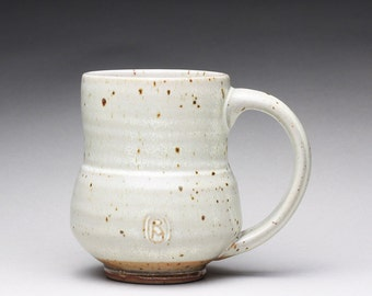 handmade pottery mug, ceramic teacup, stoneware cup with clear white and orange shino glazes