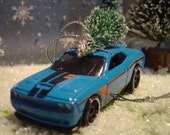 2015 Dodge Challenger SRT car with Christmas tree ornament