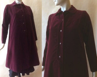 1970's swing coat in mulberry velveteen, I Magnin, calf length, lined in red taffeta, round collar, hip pockets, small - medium / size 6 - 8