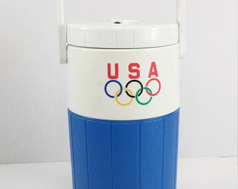 Vintage olympics Igloo half gal Relief Pitcher Insulated Drink Thermos made in USA