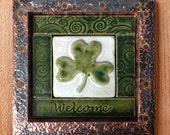 """Handmade ceramic tile, welcome with a shamrock in a 6x6"""" frame"""