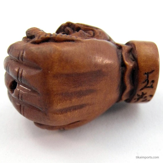 Dragon in palm hand carved boxwood ojime bead nice