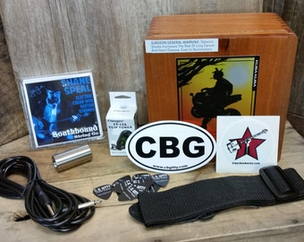 The Cigar Box Guitar Player's Gift Pack - a box full of CBG essentials & accessories! (Product # 90-040-01)