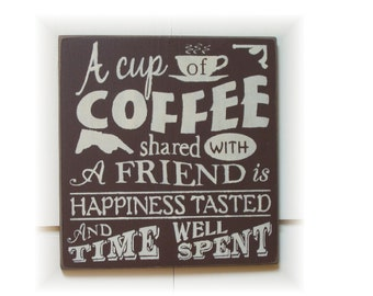 A cup of coffee shared with a friend... typography wood sign