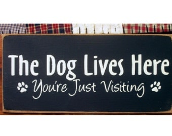 The Dog Lives Here you're just visiting primitive wood sign