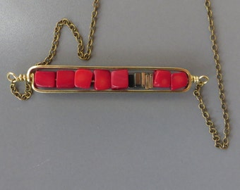 medium brass horizontal frame with red coral and hematite necklace