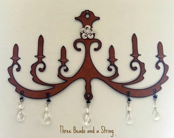 Rusty Metal Chandelier with Crystals and Brooch Wall Decoration