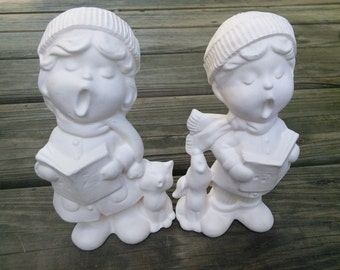 Two Ceramic Carolers ready to paint!