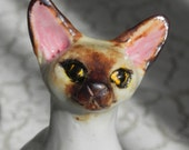 reserved jomarie -- curious cat in porcelain
