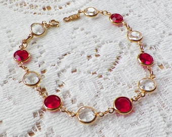 Swarovski Ruby Red and Clear Bezel Set Glass / Crystal Gold / Gold Tone Bracelet