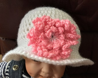 White hat with flower