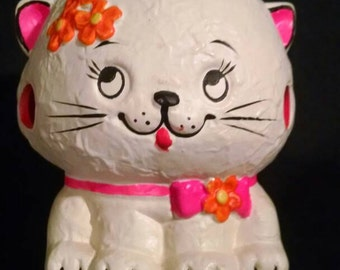 Adorable kitten is a blacklight reactive candle holder