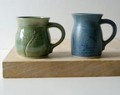Two mismatched mugs - hand thrown stoneware glazed in forest green and smokey blue