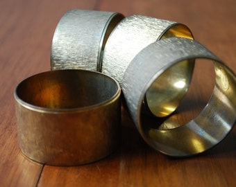 four round brushed brass napkin rings -  minimalist - modern