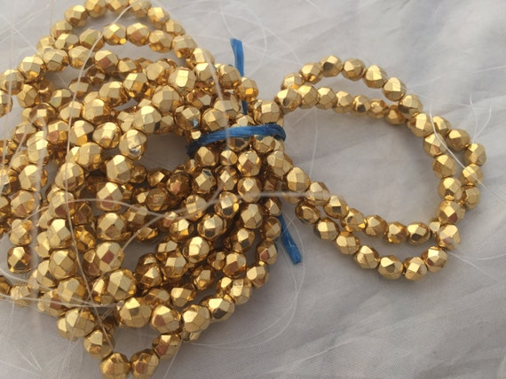 Vintage  beads  metallic gold faceted 7 mm Lot of 27 beads Hard to find Bright High quality fire polished hard to find Gold tone Glitzy