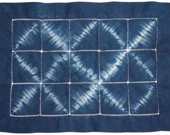 Two linen indigo shibori placemats