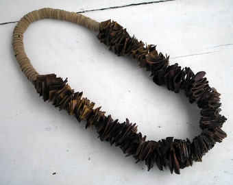 organic necklace fromseeds of carob tree,and acorn