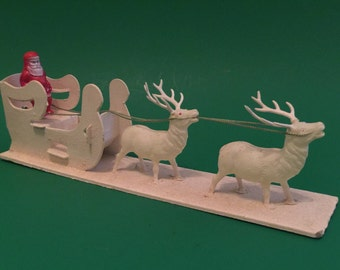 Vintage Celluloid Santa in Sleigh and Reindeer