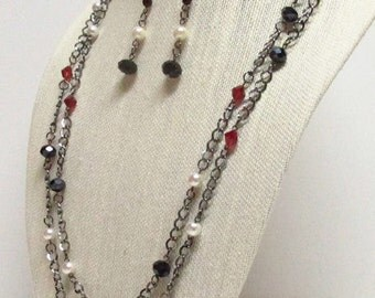 60 inch Ivory, Red and Black beads on Gunmetal Chain