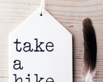 porcelain wall tag screenprinted text take a hike.