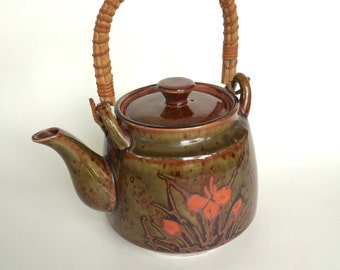 Retro Brown, Green, and Orange Porcelain Teapot with Rattan Handle