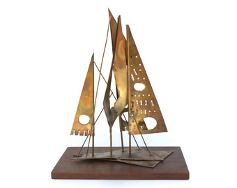 Brutalist Metal Abstract Sailboat Sculpture with Triangle Shaped Sails and Pierced Geometric Embellishments
