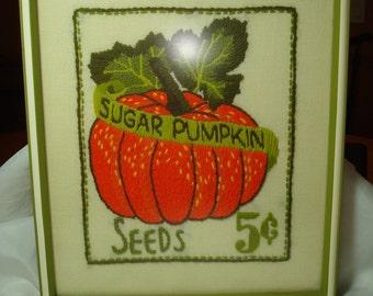 1978 Handmade Framed with Non glare Glass Sugar Pumpkin Pumpkin Seeds Crewel Work Piece.