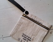 Wristlet made from vintage money bag with black strap