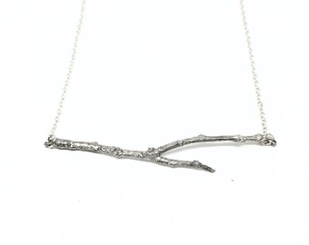 tree twig in sterling silver with a silver chain