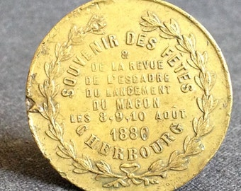 French commemorative souvenir from the launch of the cruiser Magon. 1880 antique memorabilia golden coin medal from France.