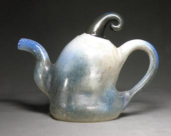 Handmade, wheel thrown and manipulated ceramic teapot.  Soda fired tea pot. Blue white and black teapot.