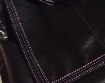 Black messenger bag with purple lining