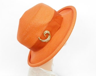 Vintage 1960s hat, orange with gold pin