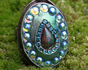 Ethiopian Black Welo Opal with Preciosa Cabochon Crystals in Antique Brass Oval Ring  Luminous Green - Serpentine