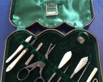 Fan Shaped Handles and Mother of Pearl Sewing Set In Black Leather Tooled Case c1920