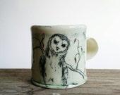 Sitting owl, a handmade porcelain mug.