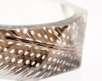 feather bracelet triangular facets resin bangle - featuring a real guinea fowl feather