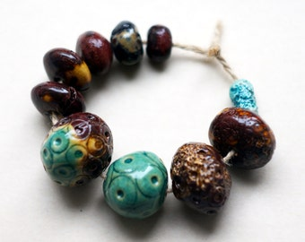 A molecular soup -- a special set of 10 rustic ceramic art beads with dotted patterns
