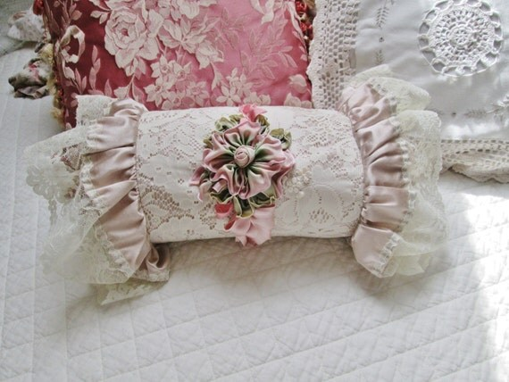 Items similar to shabby chic pink lace pillow bolster round ribbon embroidery cushion on Etsy