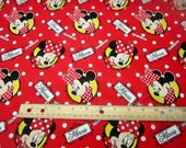 Disney Minnie Mouse Loves To Shop Badges Tossed on Red fabric by Springs Creative Fabric BTY