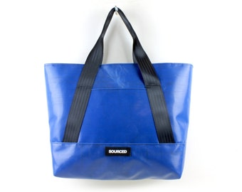 A unique truck tarp tote bag made from recycled lorry curtains. Water resistant shoulder bag with detachable strap. 1.01