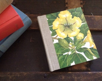 Magnolia & Hibiscus floral covered blank journal